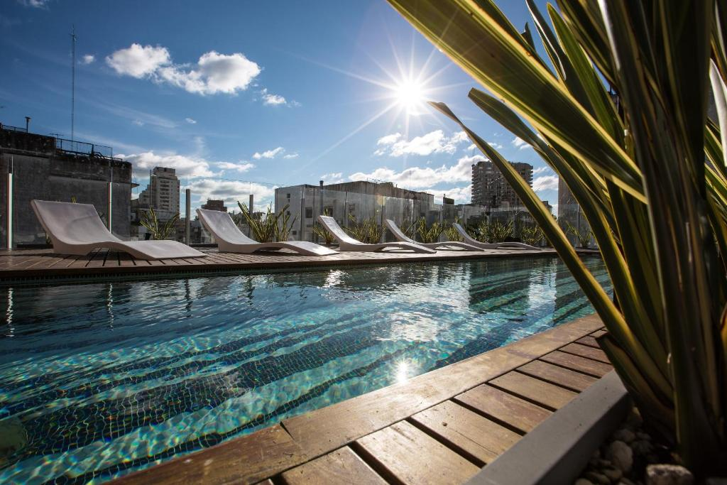 The swimming pool at or near Flaat Recoleta Plaza