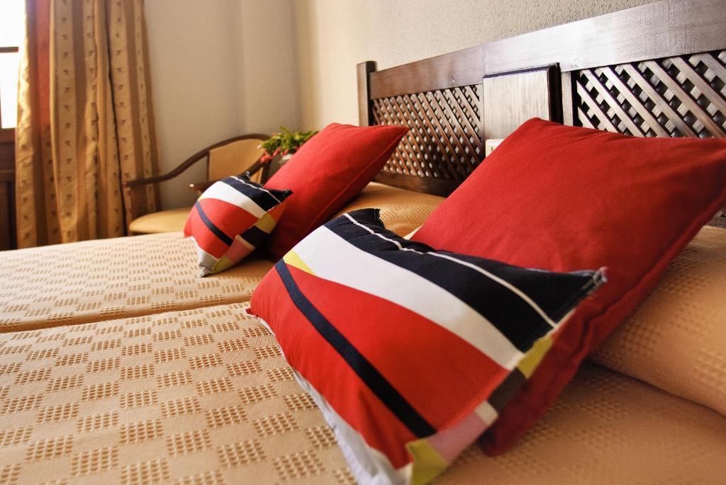 Una habitación en Hotel Galaroza Sierra