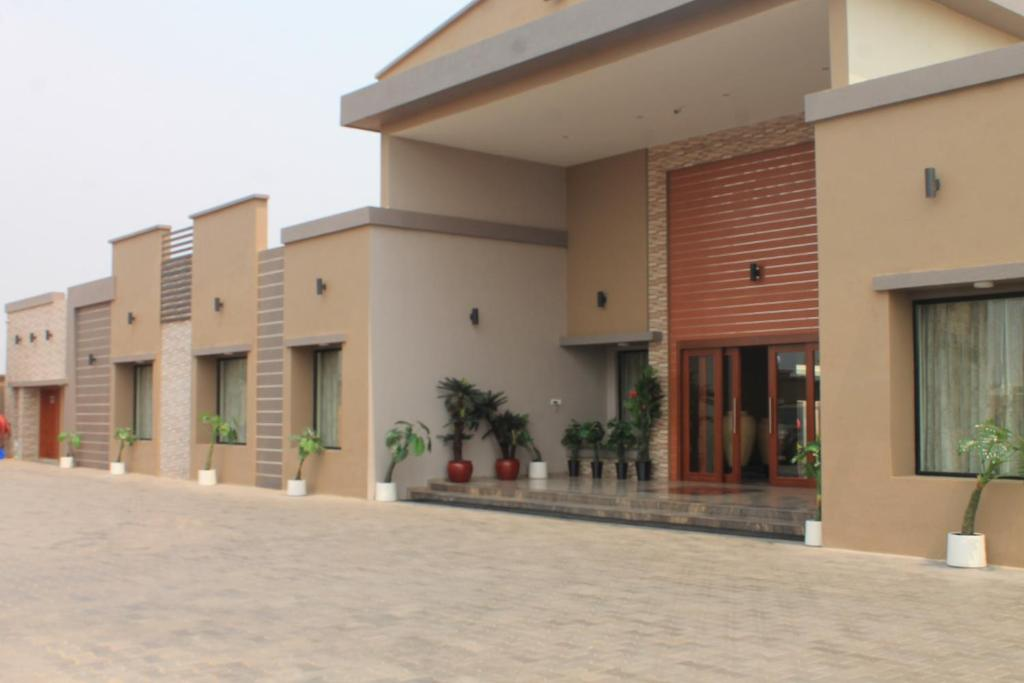 The facade or entrance of Hotel Moon Palace Kolwezi