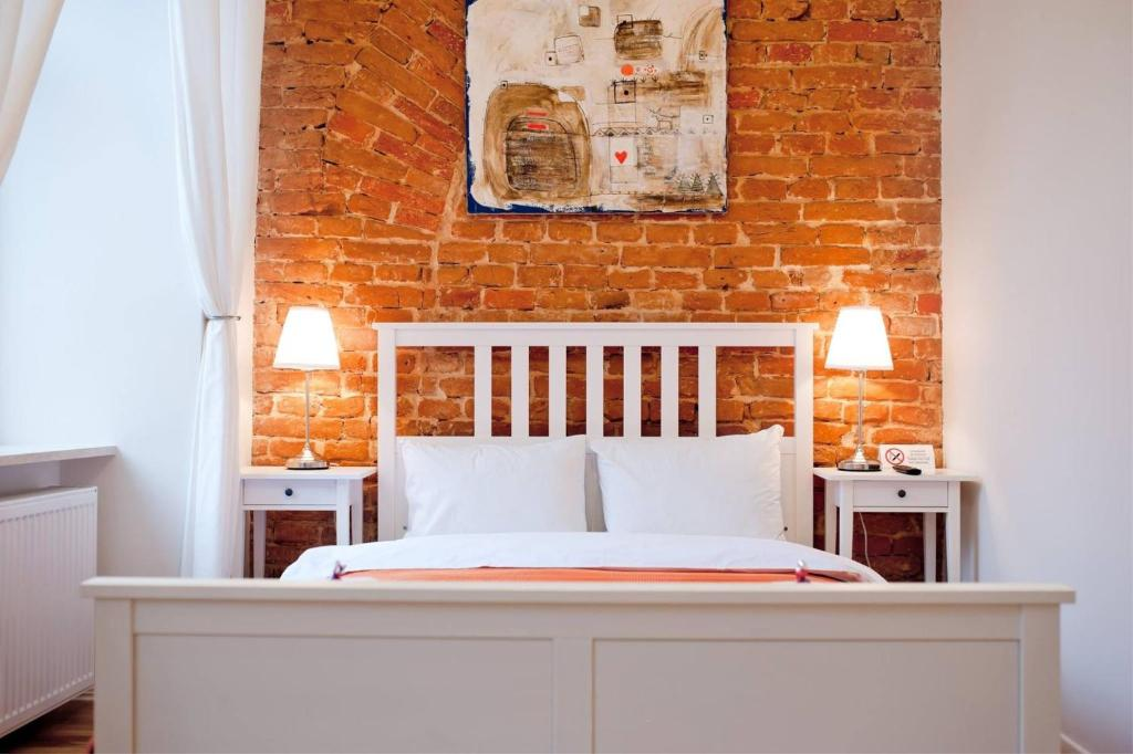 A bed or beds in a room at Danylo Inn