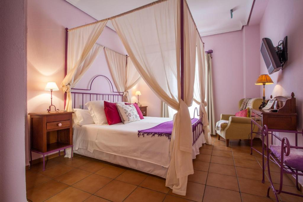 Cama o camas de una habitación en La Casa del Maestro Boutique