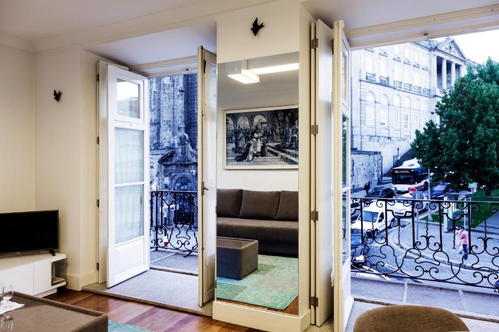 Een patio of ander buitengedeelte van Infante Apartment