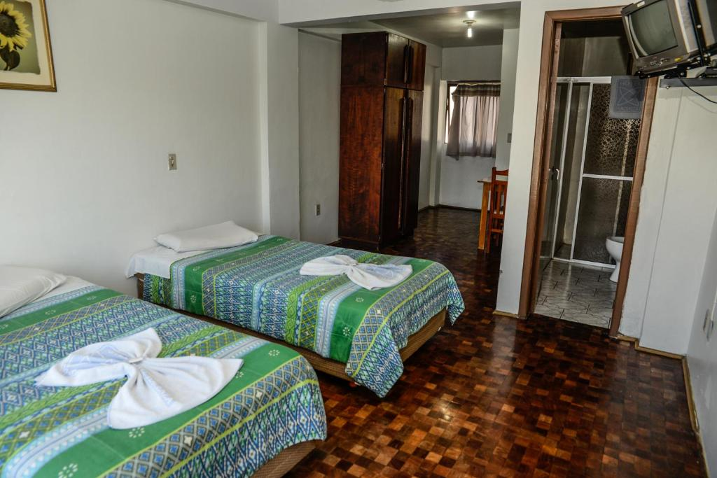 A bed or beds in a room at Hotel Piacenza