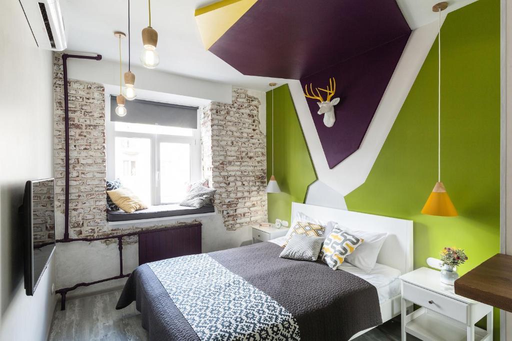 Кровать или кровати в номере Уютные апартаменты «Рубика»