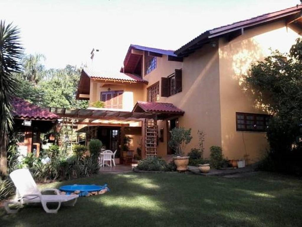 Uma varanda ou outra área externa em Casa das Palmeiras + Quiosque