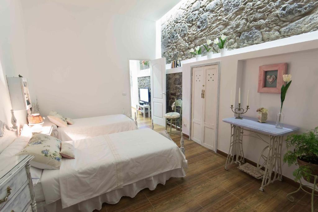 Cama o camas de una habitación en Casa Mama Fela