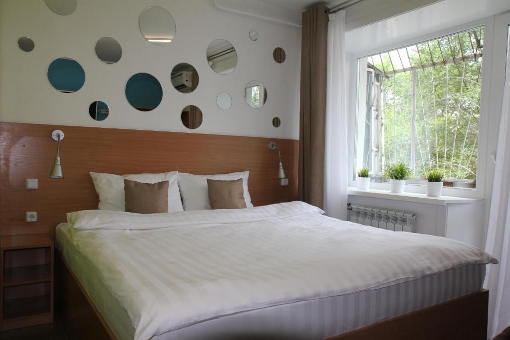 Кровать или кровати в номере Asti Hotel