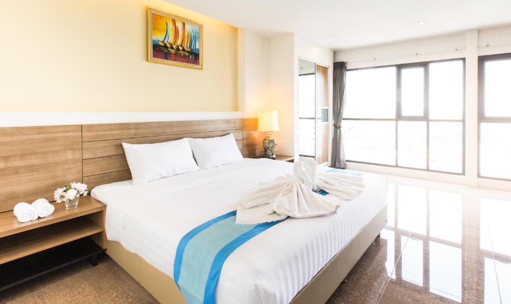 A bed or beds in a room at Viva Residence