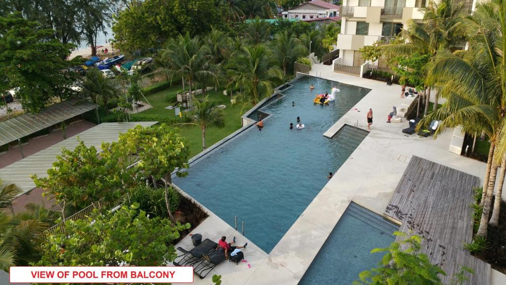 A bird's-eye view of By the Sea- Pool and Sea View