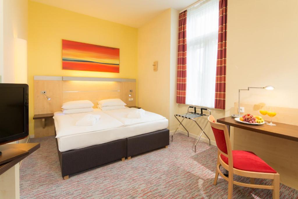 Posteľ alebo postele v izbe v ubytovaní Exe City Park Hotel