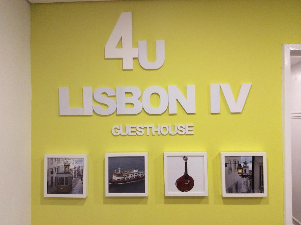 A certificate, award, sign, or other document on display at 4U Lisbon IV Guesthouse