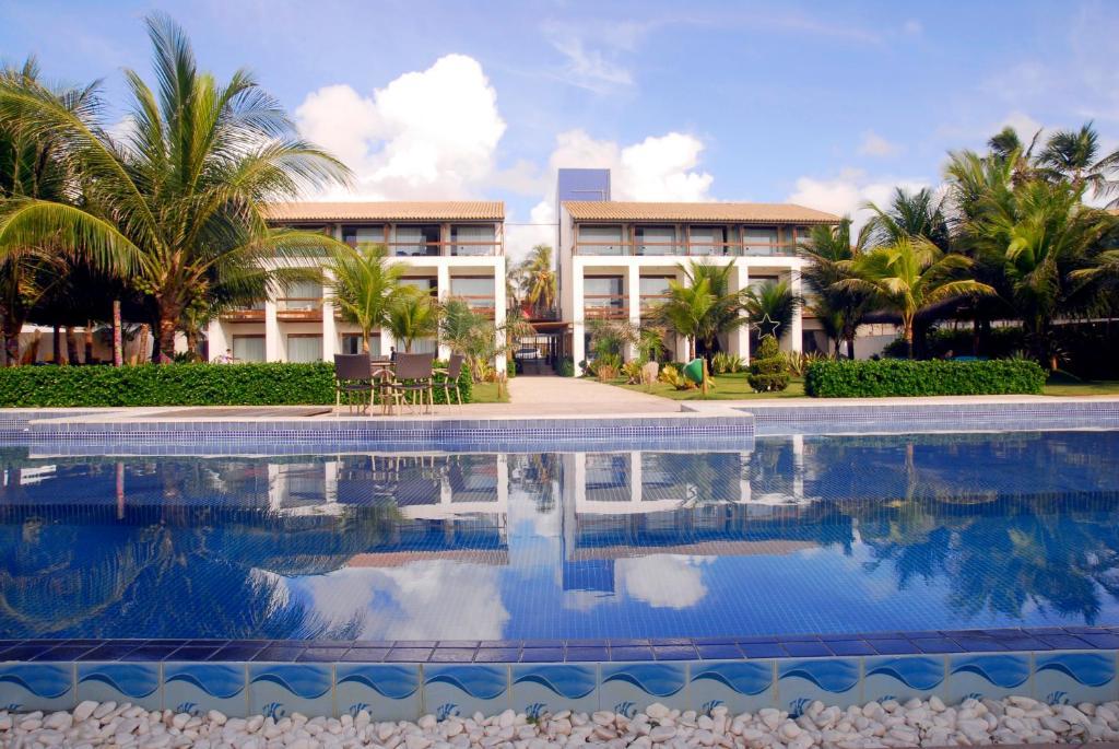 A piscina localizada em Villa da Praia Hotel ou nos arredores