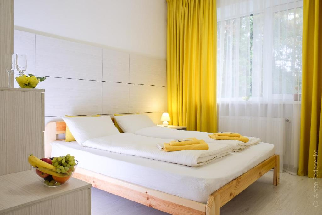 A bed or beds in a room at Hotel Black Cube