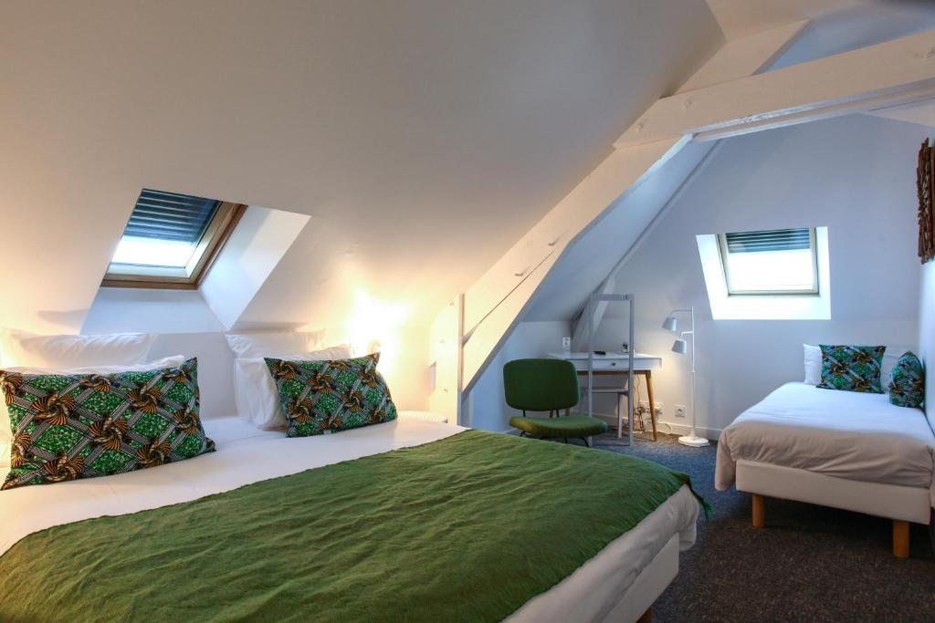 A bed or beds in a room at Hôtel Le Collonges
