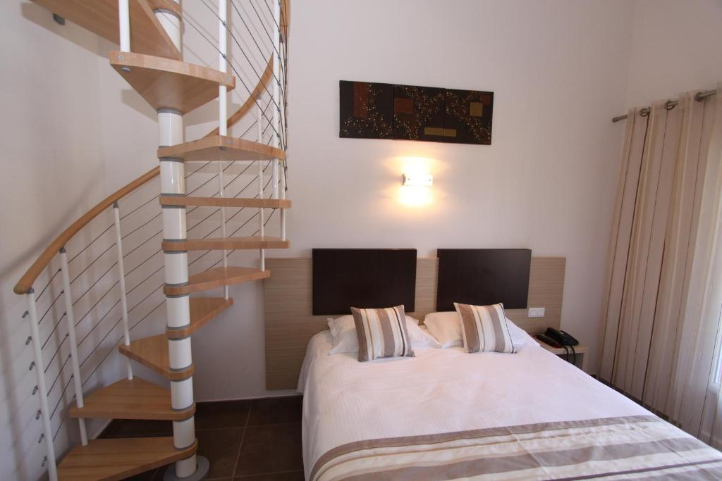 A bed or beds in a room at Hôtel A Madonetta