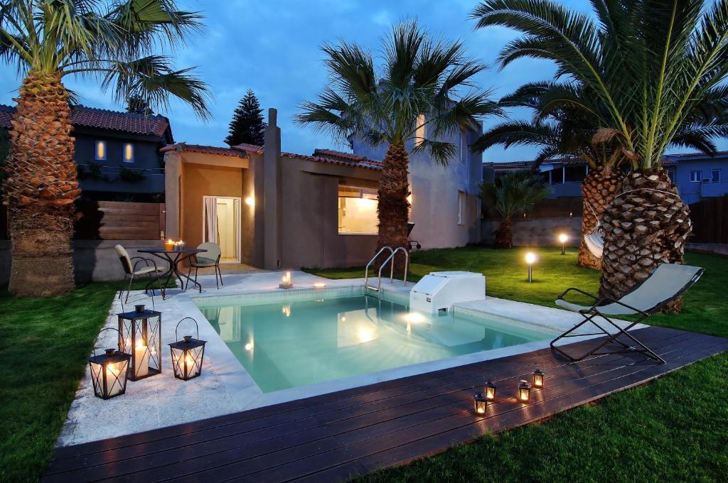 Бассейн в Paradise Island Villas или поблизости
