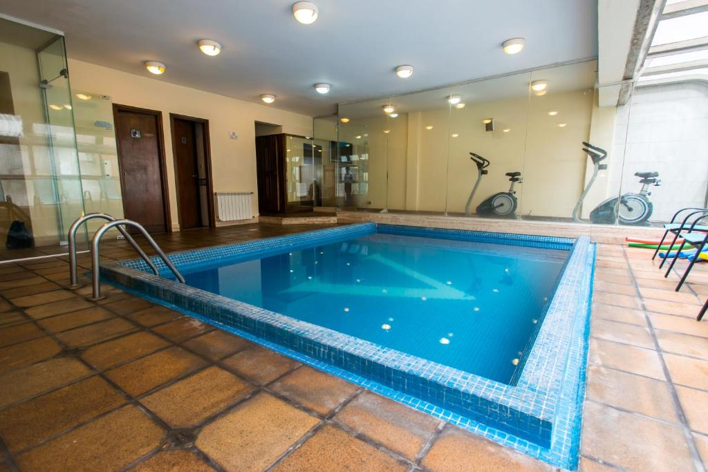 The swimming pool at or near Armon Suites Hotel