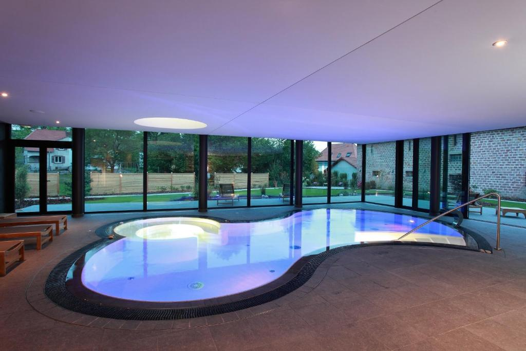 The swimming pool at or near L'auberge Du Cheval Blanc et Spa