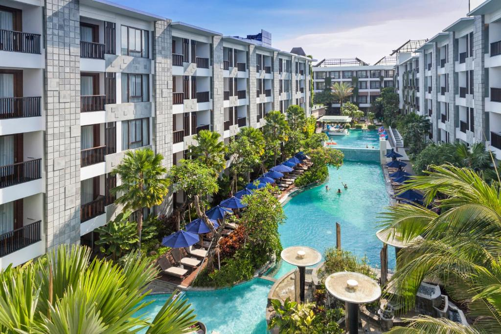 A view of the pool at Courtyard by Marriott Bali Seminyak Resort or nearby