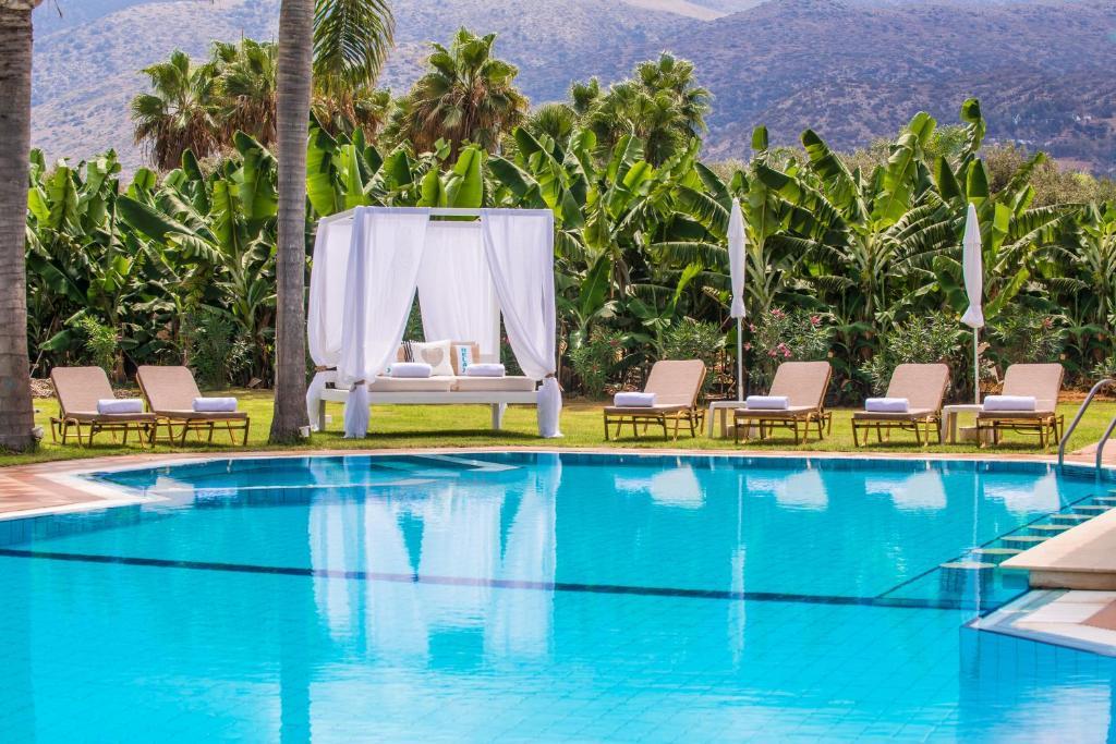 The swimming pool at or near Vergina Studios & Apartments