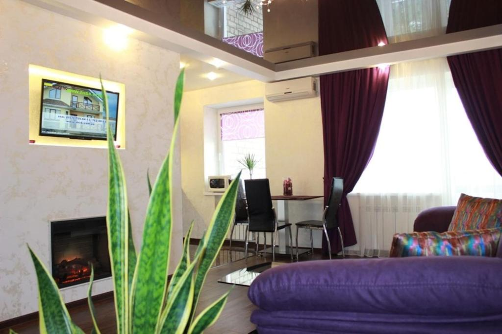 A seating area at Kharkiv Center Apartment on Hoholya Str, Poetry square