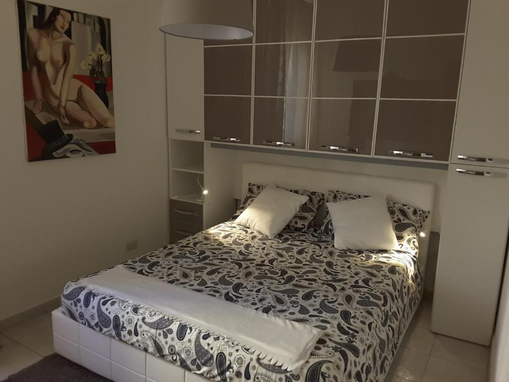 A bed or beds in a room at Casa dell'Artista