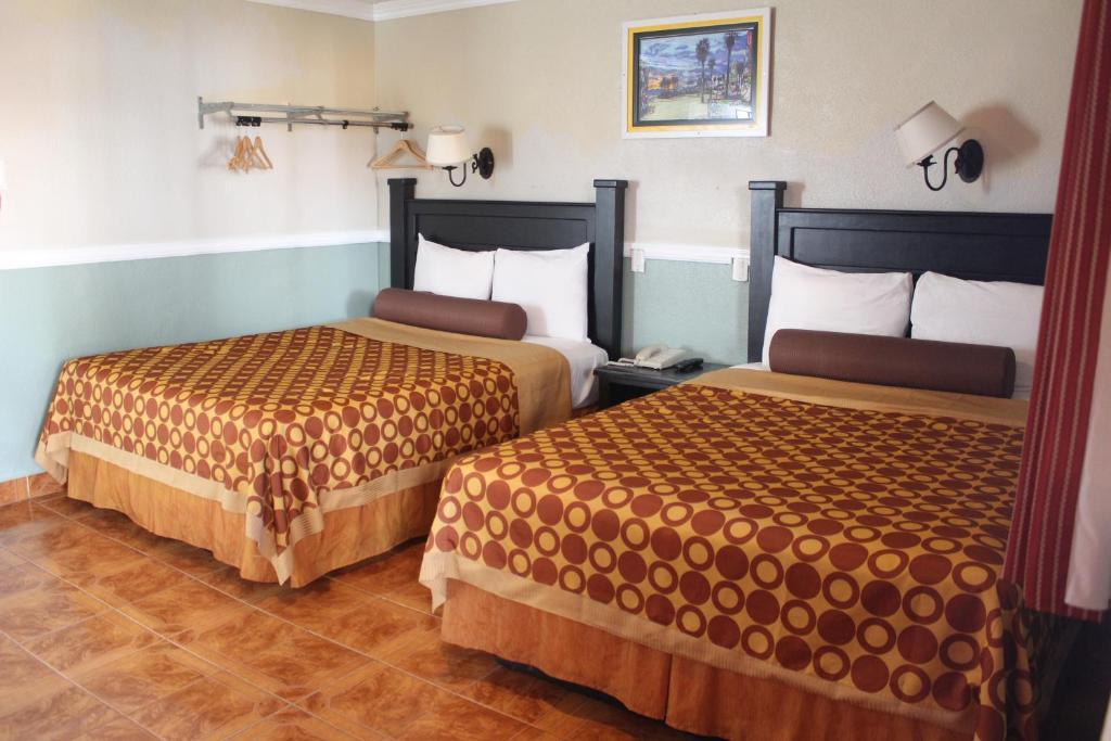 パラダイス イン アンド スイーツにあるベッド