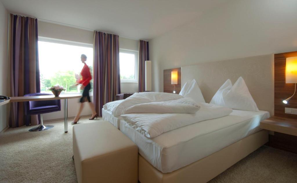 Ein Bett oder Betten in einem Zimmer der Unterkunft Cityhotel D&C St.Pölten