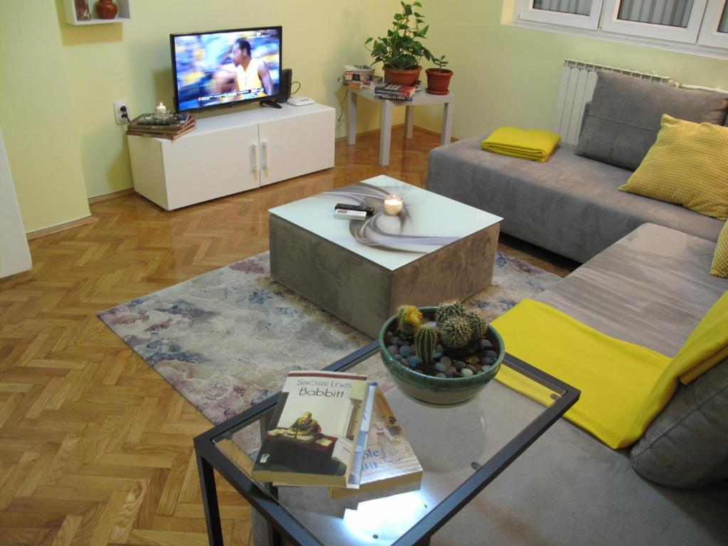Zona de lounge sau bar la Regina's Central Street Apartment