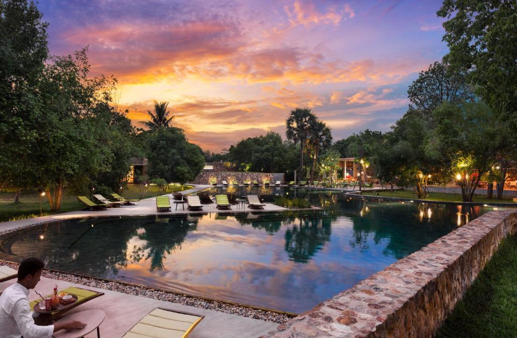 Der Swimmingpool an oder in der Nähe von Templation Hotel