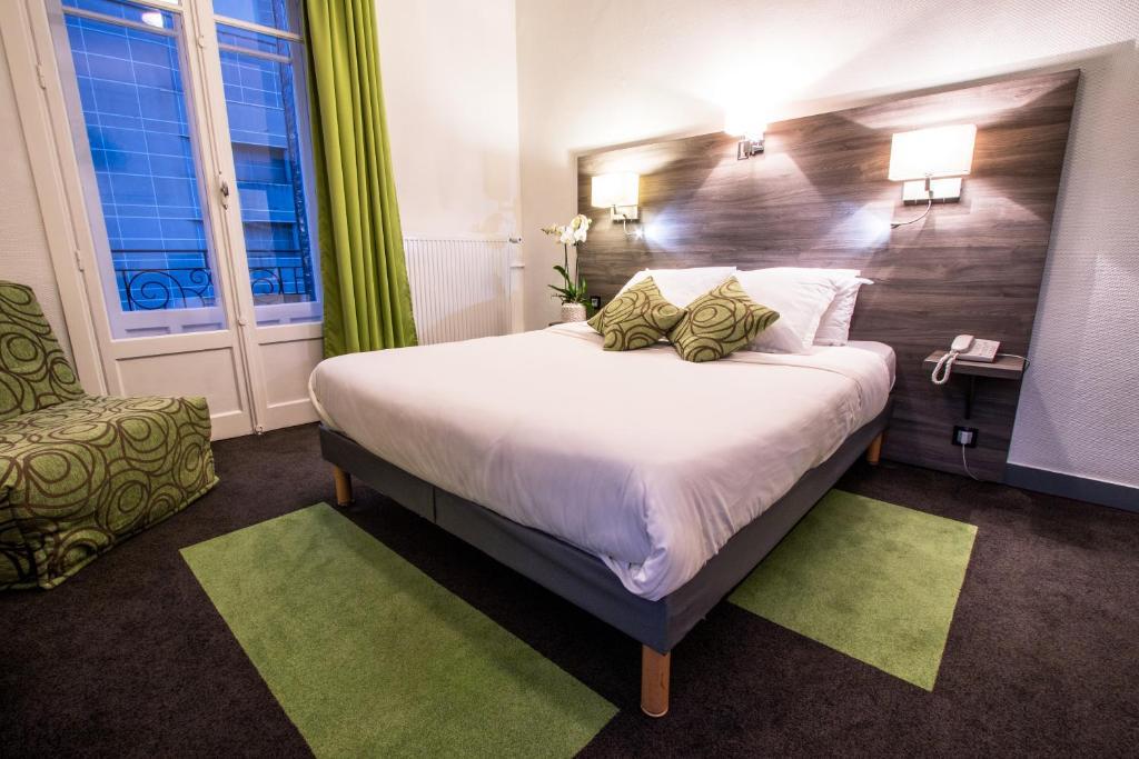 Un ou plusieurs lits dans un hébergement de l'établissement Hotel Actuel Chambéry Centre Gare