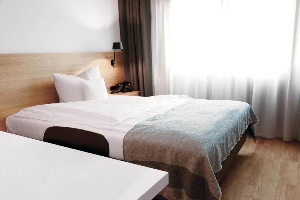 Ein Bett oder Betten in einem Zimmer der Unterkunft Hotel Stadt Balingen