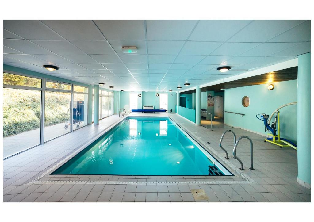 The swimming pool at or near Résidence Le Royal by Actisource