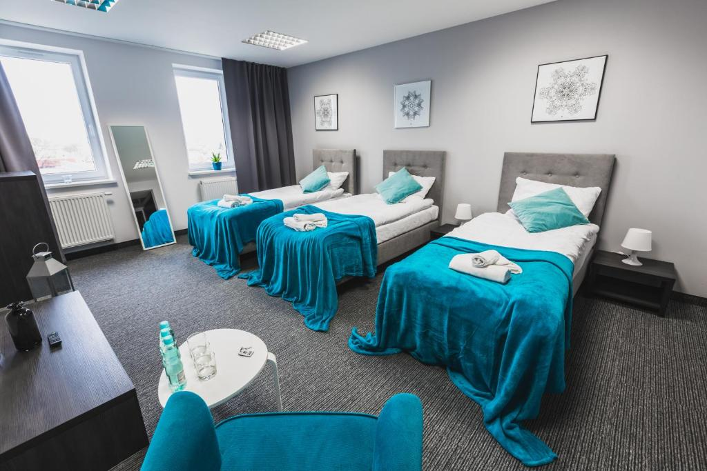 A bed or beds in a room at Czarno Na Białym