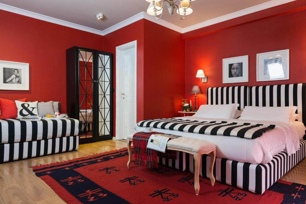A bed or beds in a room at Areela Boutique Hotel