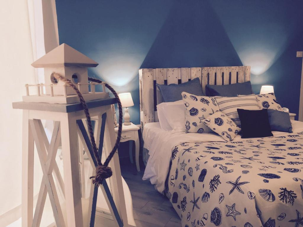 A bed or beds in a room at The Lighthouse