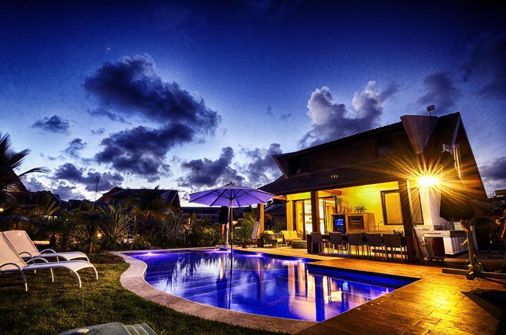 The swimming pool at or close to Novo Bangalô no Malawi Beach House com Premium Service