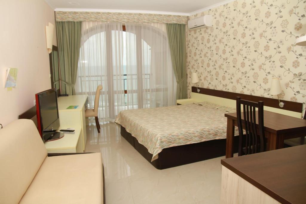 Posteľ alebo postele v izbe v ubytovaní Apartment in Grand Hotel Sveti Vlas