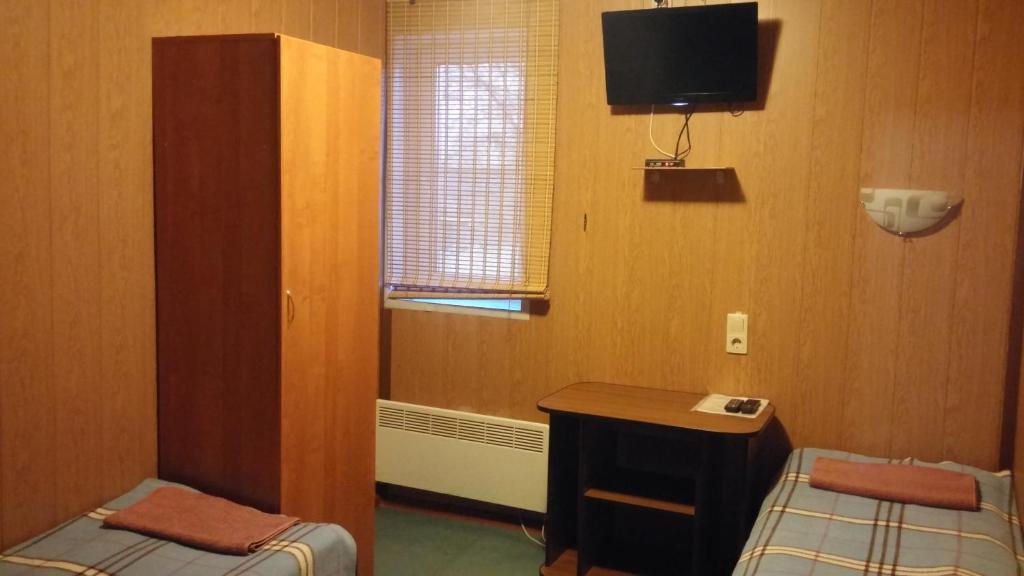 Телевизор и/или развлекательный центр в Мотель Как Дома