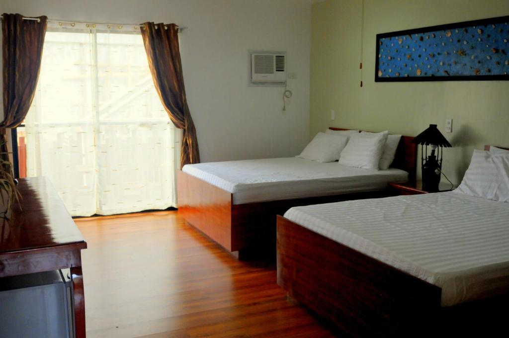 A bed or beds in a room at Oasis Resort and Spa