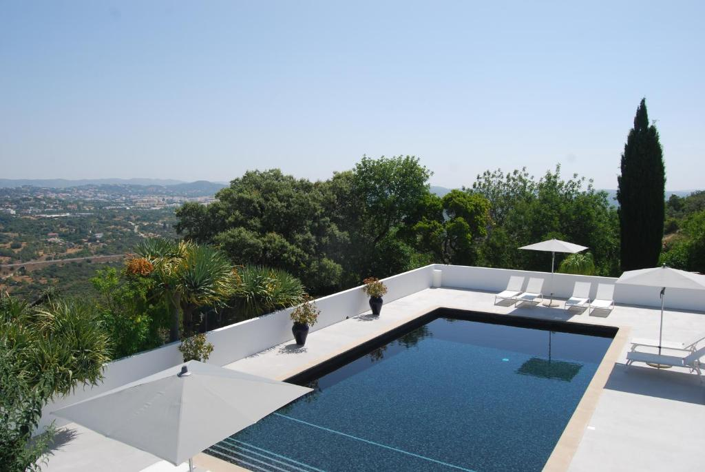 A view of the pool at Farmhouse Of The Palms or nearby