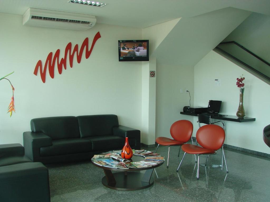 Uma área de estar em Hotel FIT