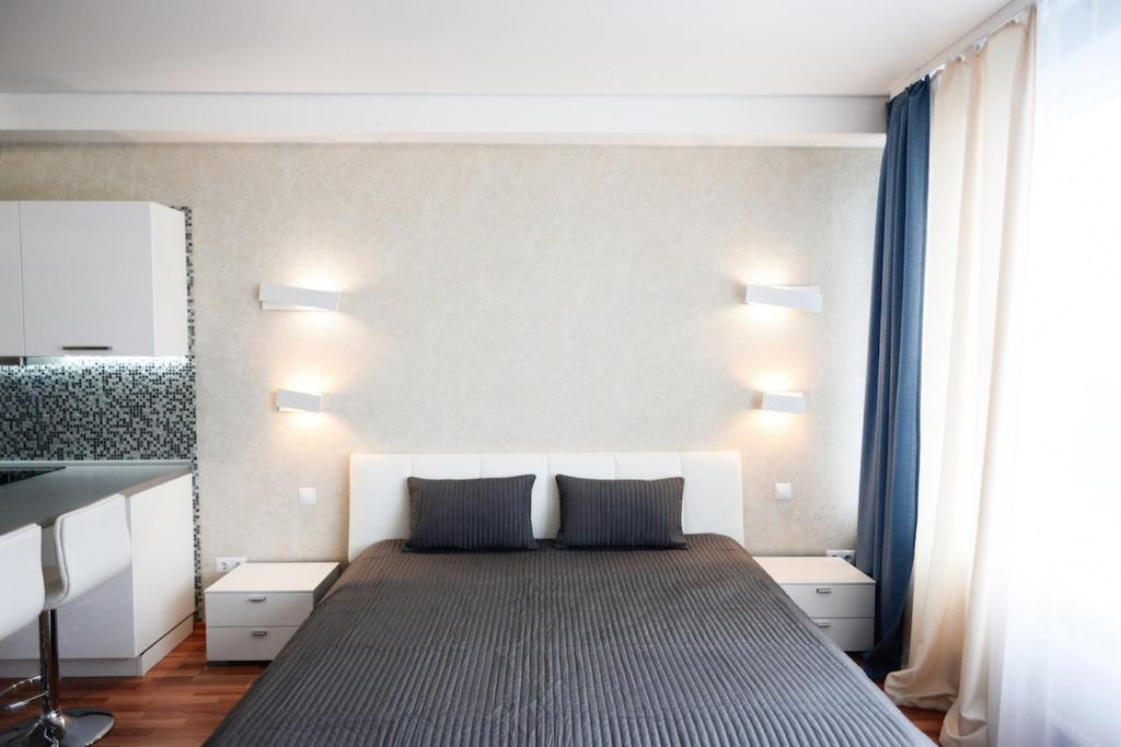 Кровать или кровати в номере Огни Екатеринбурга Белинского 108