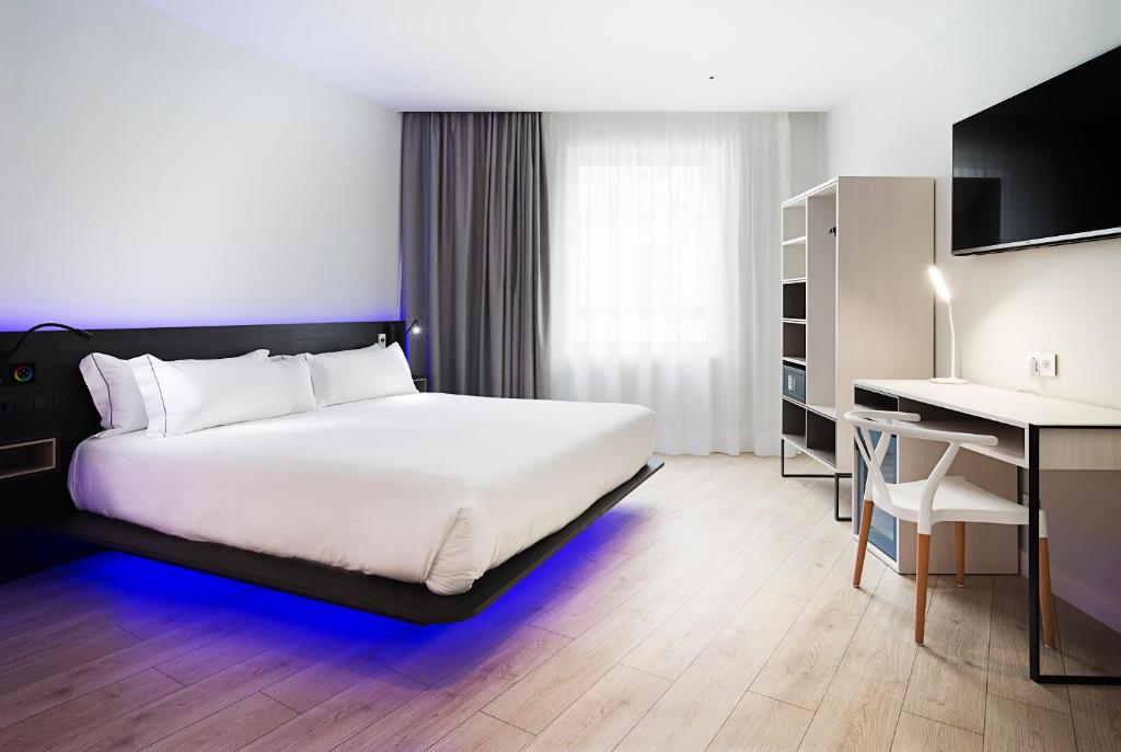 A bed or beds in a room at B&B Hotel Madrid Centro Puerta del Sol