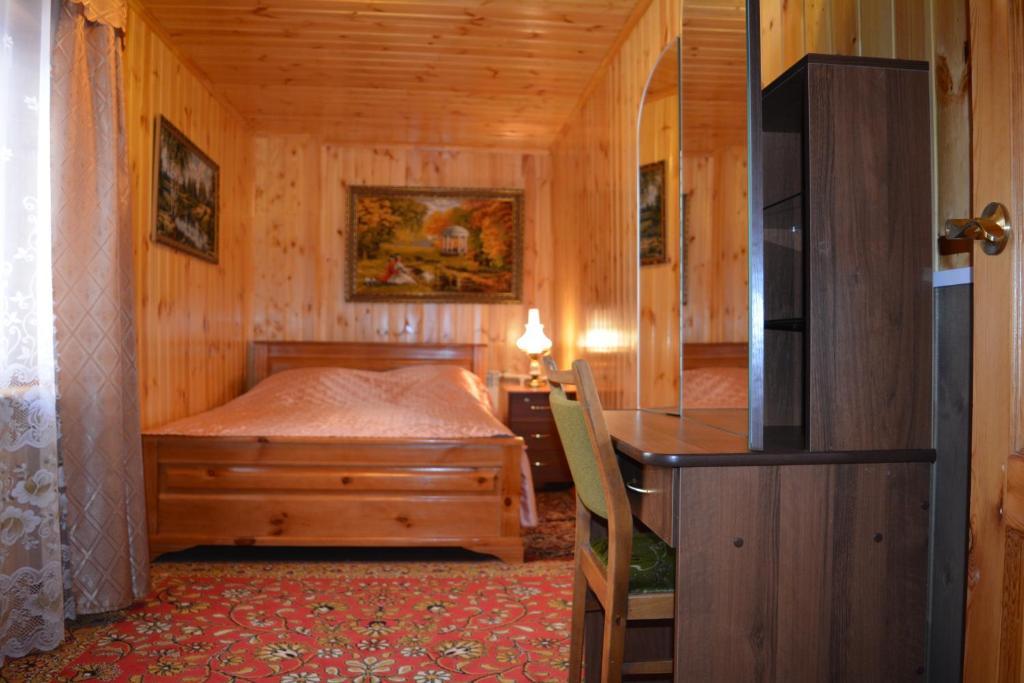 Кровать или кровати в номере В гостях у Юлии