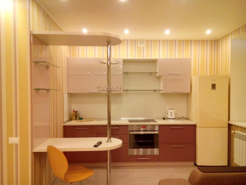 Кухня или мини-кухня в Apartment on Lenina 135/2