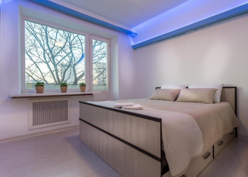 Кровать или кровати в номере Apartment on Novyy Arbat 34