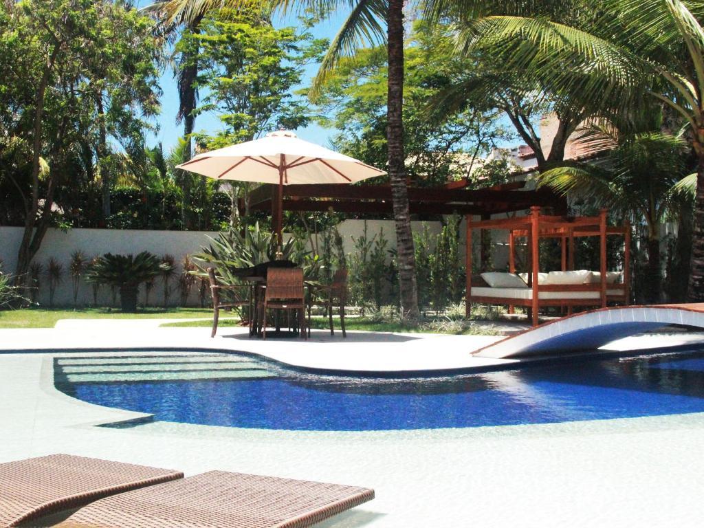 Hotel Boutique Recanto da Passagemの敷地内または近くにあるプール
