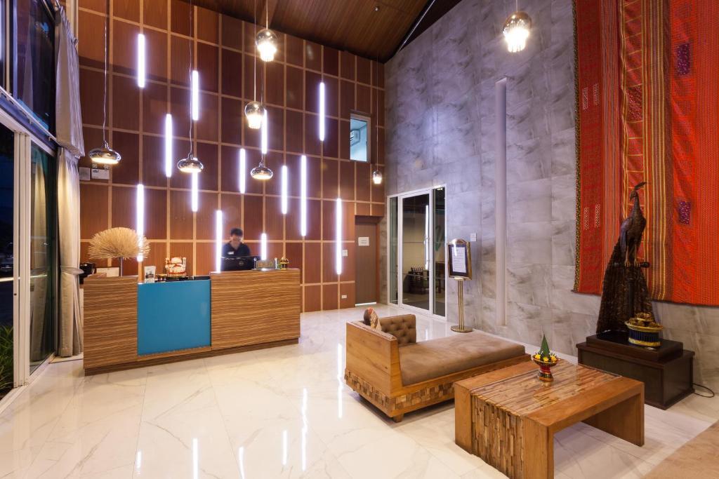 The lobby or reception area at We Briza Hotel Chiangmai