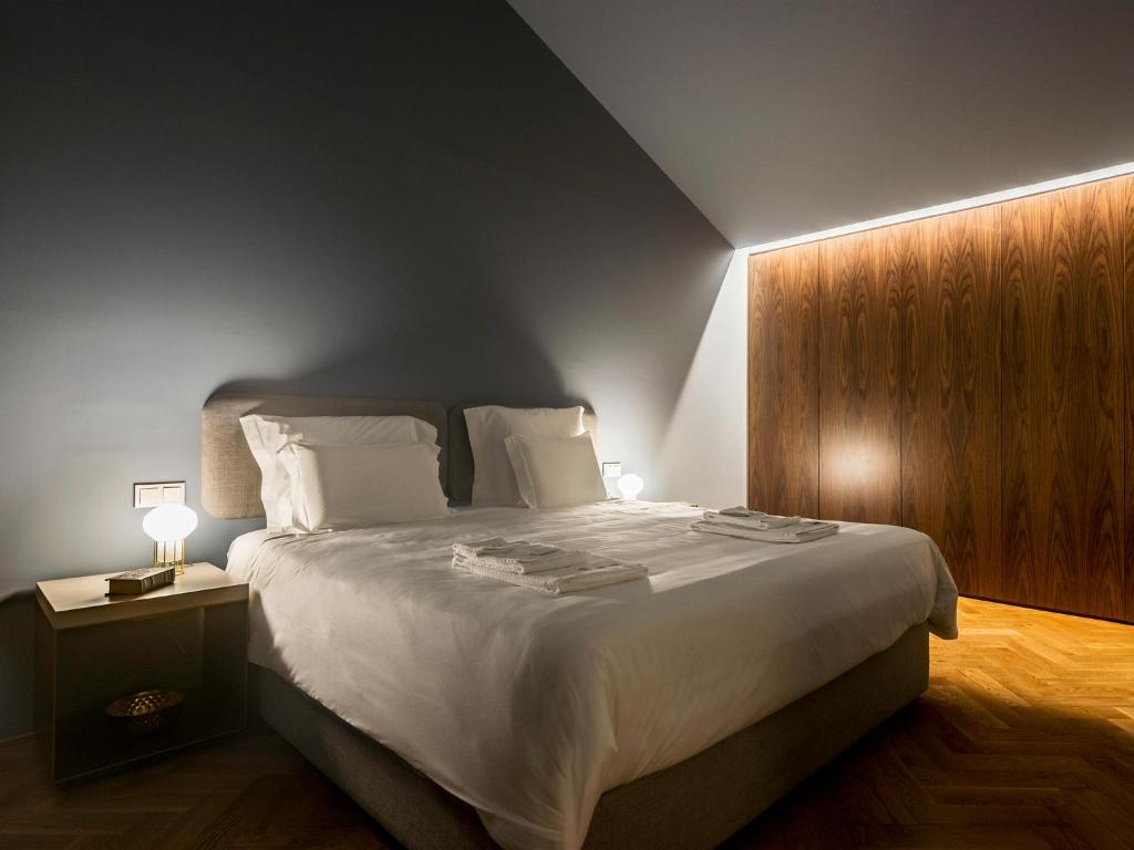 A bed or beds in a room at Domum 2